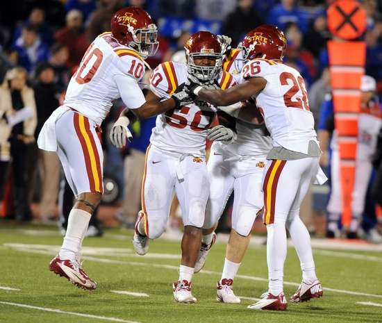 Cyclone defenders celebrate an interception by Willie Scott - John Rieger-US PRESSWIRE