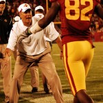 Paul Rhoads congratulates Marquis Hamilton following a TD reception