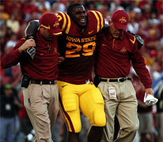 Rashawn Parker gets helped off the field after a left knee injury