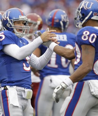 Reesing celebrates with Dezmon Briscoe after a TD
