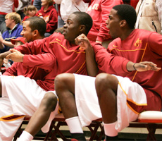 The Iowa State bench reacts during a nail biting win over Houston