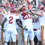 Jake Knott hugs Head Coach Paul Rhoads after sealing the victory with an interception